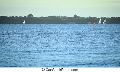 Time lapse of sailboats sailing on water of sea, lake or river,