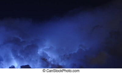 Time lapse of severe thunderstorm clouds at night with...