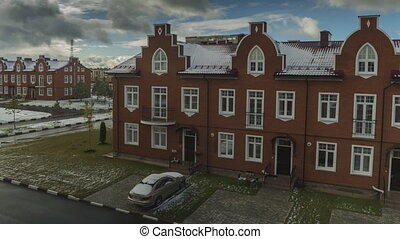 Time lapse of snow melting on red brick town houses clip
