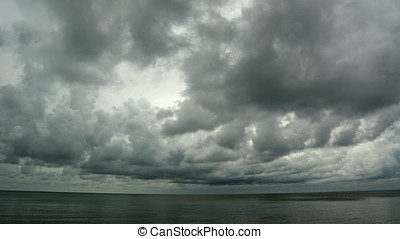 Time lapse of storm clouds rolling in over the ocean