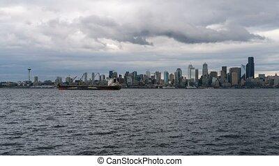 Time lapse of stormy sky over Seattle WA city skyline from Alki Beach 4k UHD