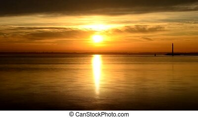 Time lapse of sun rise at dawn on the sea, ocean or river