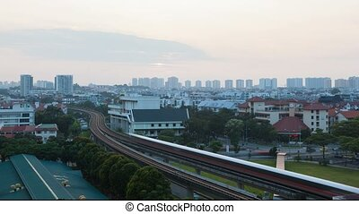 Time lapse of sun rising over public transportation in Eunos...