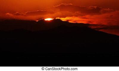 Time lapse of sun setting behind Eynali Mountains