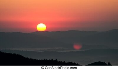 Time lapse of sunrise in Carpathian Mountains with lens flare