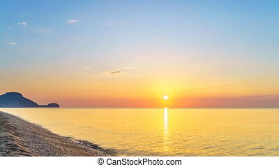 Time lapse of sunrise over sea beach in Rhodes, Greece