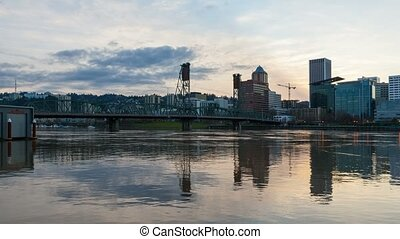 Ultra high definition 4k time lapse movie of colorful sunset and moving clouds over downtown city of Portland Oregon and Hawthorne bridge with water reflection into blue hour and night