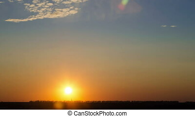 Time lapse of sunset over flat landscape