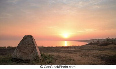 Time lapse of sunset over the Sea of Azov coast with...