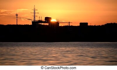 Time lapse of sunset with hydroelectric power plant