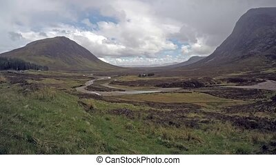 Time lapse of the amazing landscape of Glencoe with sun,...
