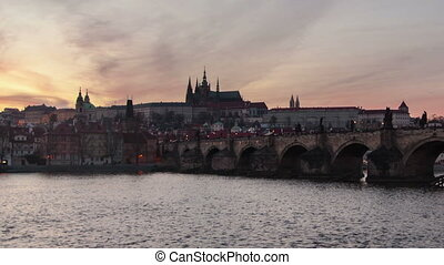 Time lapse  of the Charles Bridge in Prague with a day-to-night transition