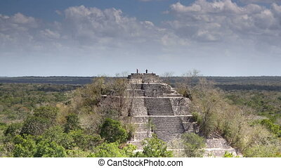 time-lapse of the mayan ruins at kalakmul, mexico. the...