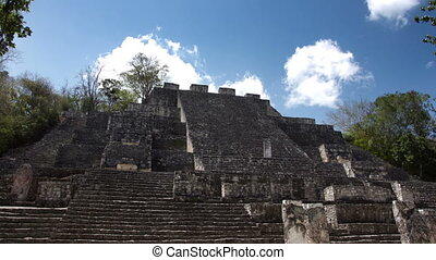 time-lapse of the mayan ruins at kalakmul mexico. the mayans...