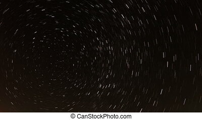 Time lapse of the night sky with clouds and stars passing by...