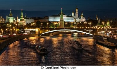 Time lapse of the night view to the Kremlin, Big Stone Bridge, Moscow River with boats and Kremlin's Embankment in the summer, time lapse, 4k.