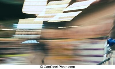 Time lapse of the shopping cart moving between various...