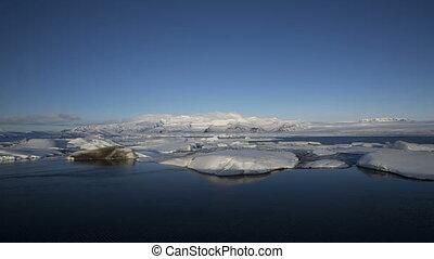 Time lapse of the sunrise at glacier lagoon Jokulsarlon,...