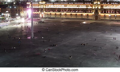 time-lapse of the zocalo in mexico city at night, with the cathedral and giant flag in the centre