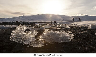 Time lapse of tourists at glacier lagoon Jokulsarlon,...
