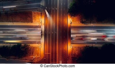 Time lapse of traffic at night on highways at night time with car light illumination