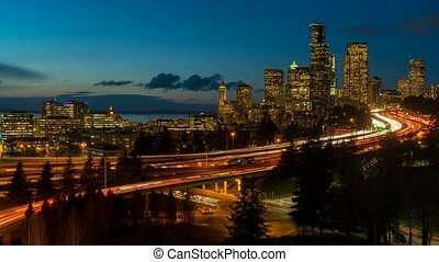 Time lapse of traffic light trails on freeway in Seattle WA at sunset into night