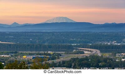 Time lapse of traffic on Glenn Jackson bridge with sunset over Mt. St. Helens 4k