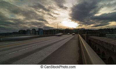 Time lapse of traffic on Ross Island bridge in downtown Portland Oregon at sunset