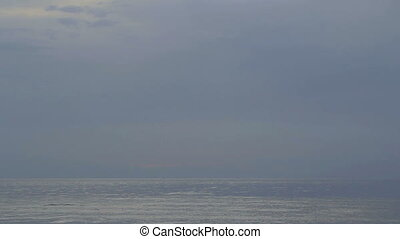 """Time lapse of tranquil open sea with rippling water surface. Calm misty seascape"""