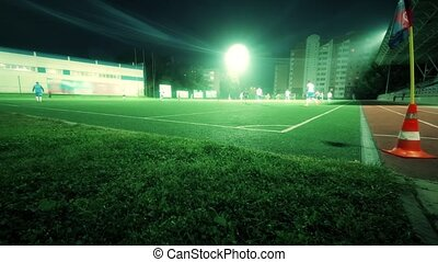 Time lapse of unknown amateur fooball teams playing game in...