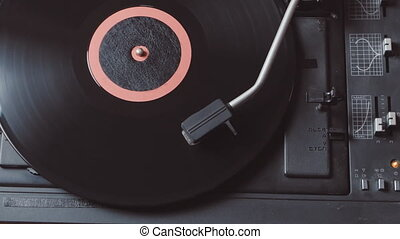 Time-lapse of Vinyl rotating on a turntable, top view - Old...
