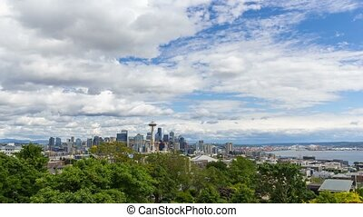 Time lapse of white clouds and blue sky over Seattle WA cityscape and Puget Sound 4k uhd