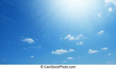 Time lapse of white clouds on blue sky