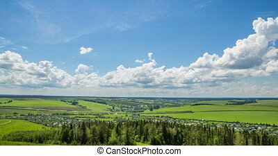 Time lapse over a beautiful flat landscape shot at different...