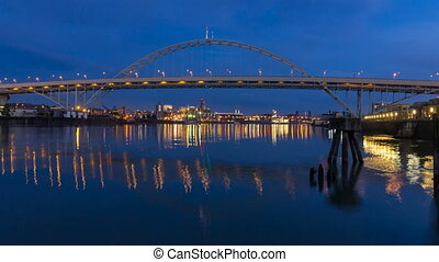 Time Lapse Movie of Vehicular Traffic and Colorful Water Reflection Over Fremont Bridge in Portland Oregon at Blue Hour into Night 1920x1080