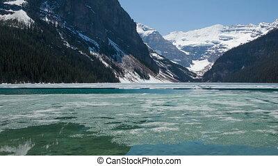 Time lapse pan shot broken ice lake - Time lapse pan shot of...