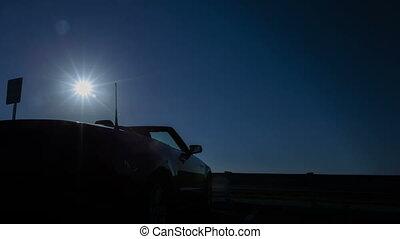 Time lapse pan shot convertible sun - Time lapse pan shot of...