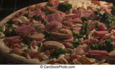 Time lapse pan shot pizza with ham - Time lapse pan shot...