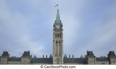 Time lapse zoom out Parliament Hill building closeup in Ottawa, Canada at daytime mit clouds passing by