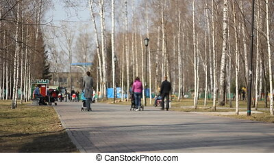 Time-Lapse. Peoples walking in park