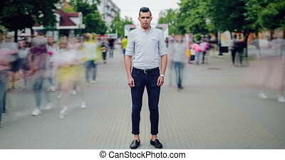 Time lapse portrait of handsome Arabian man in casual...