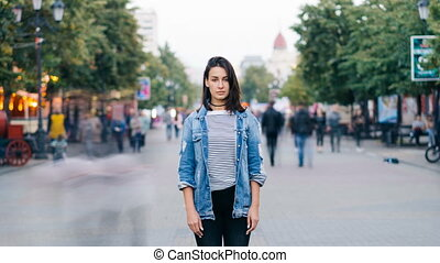 Time-lapse portrait of tired woman student standing alone in...