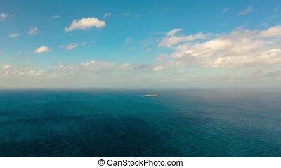 Time lapse: Seascape, island and sky with clouds, Cebu,...