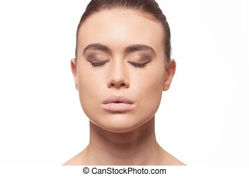 Time lapse sequence of makeup being applied to the model's face