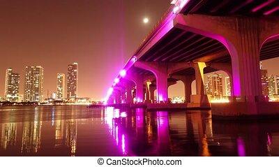 Time lapse shot of Mc Arthur Causeway Bridge to Miami Beach at night - Miami Timelapse 4k- MIAMI, FLORIDA - APRIL 10, 2016