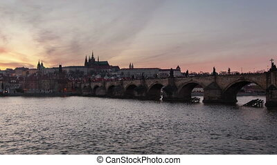 Time lapse shot of the Charles Bridge with day-to-night transition in spring