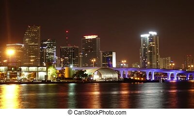 Time lapse shot of the colorful Miami Skyline at night - Miami Timelapse 4k - MIAMI, FLORIDA - APRIL 10, 2016