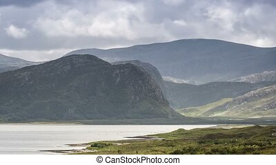 Time Lapse, Sky And Clouds Over Mountain Range, Loch Erribol, Scotland, Close Up, Pan
