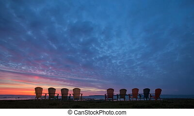 Time lapse Sunrise behind Chairs