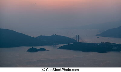 Time lapse sunset arial view on the Hong Kong Tsing Ma Bridge